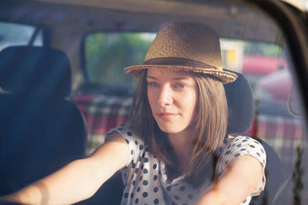 oldtimer: Retro style woman driving old timer car. Stock Photo