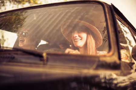Retro style woman driving old timer car  Traveling with her friends  photo