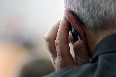 80 plus adult: Senior man talking on telephone Stock Photo