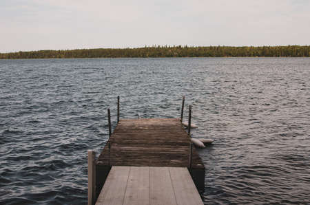 Dock and wavy water on Child's Lake in Duck Mountain Provincial Park, Manitoba, Canada