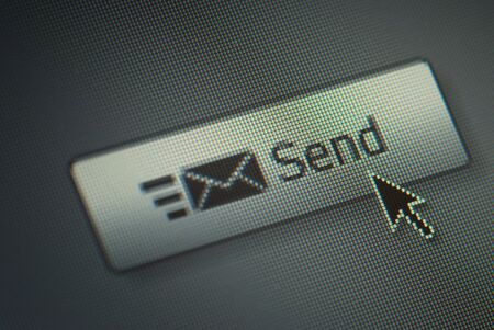 na: Close-up of a send button and na hand mouse cursor Stock Photo