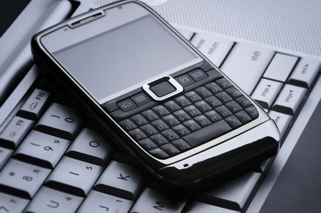 smart cell phone on a silver laptop