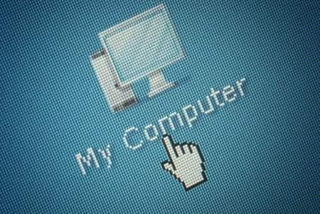 Close-up of an interface computer button and a hand mouse cursor photo