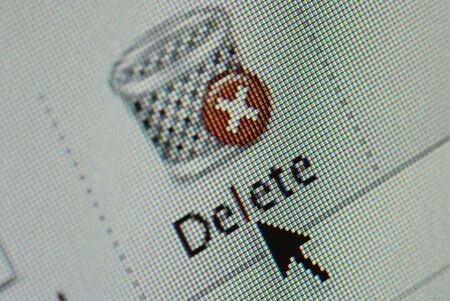 junk mail: Close-up of an interface computer delete and junk mail buttons and an arrow cursor
