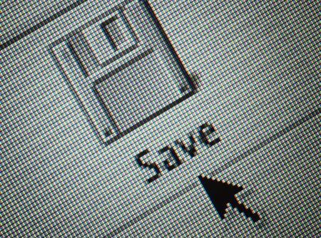 Close-up of an interface computer save button and an arrow mouse cursor photo