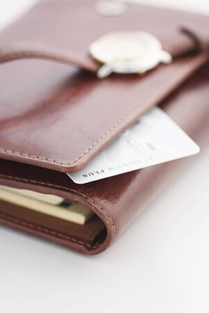 tabbed binder: credit card and a watch on a agenda,business background Stock Photo