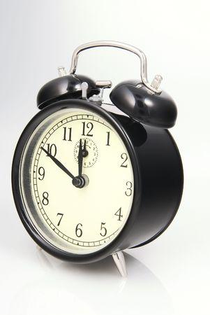 8 12: Alarm clock set to ten to twelve,Time Concept Stock Photo