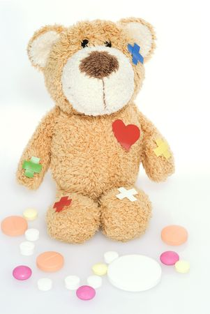teddy bear in hospital on a white background