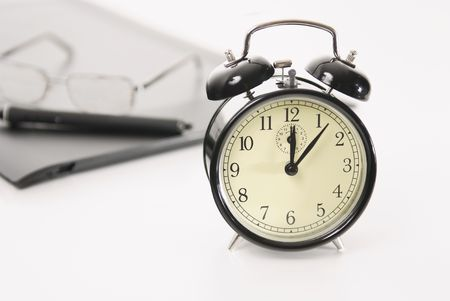Image of retro alarm clock and business objects on workplace,Time concepts-Break Time photo