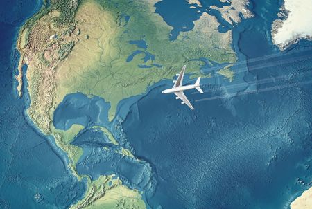 White Civil Airplane over the Atlantic ocean flying to the USA Archivio Fotografico
