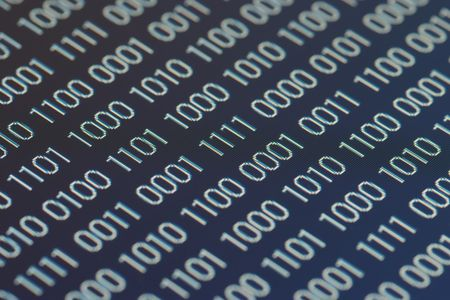 close up of binary code on a blue background photo