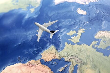 White Civil Airplane over the Atlantic ocean flying from Europe to the USA photo
