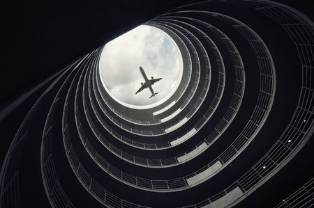 Landing passenger airplane, seen from inside of a car parking Stok Fotoğraf