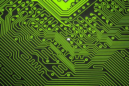 Close up of a green circuit board without components photo