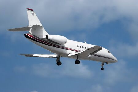 corporate jet: Large double engine business jet landing Stock Photo