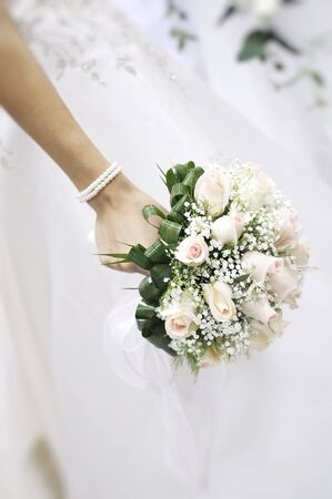 Focus on Bridal bouquet on the wedding ceremony photo