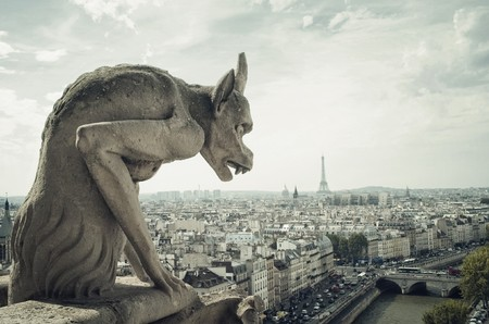 Panoramic of Paris  wit Gargoyle architectural fragment in foreground, taken from the roof of Cathedral Notre Dame Stok Fotoğraf