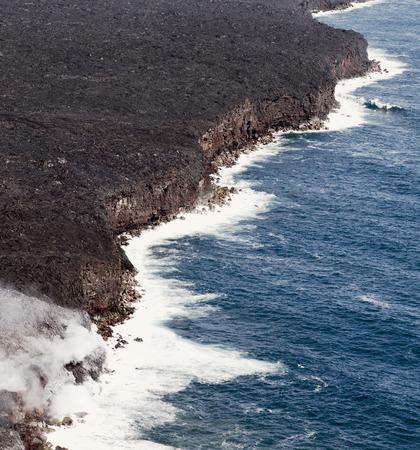 Kilauea lava enters the ocean, expanding coastline.  Kilauea Volcano, Hawaii.