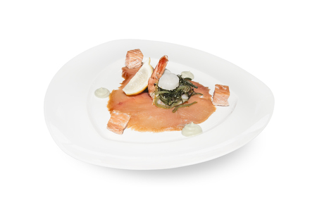 king salmon: Smoked Salmon and King Prawn Appetizer plate isolated over white background