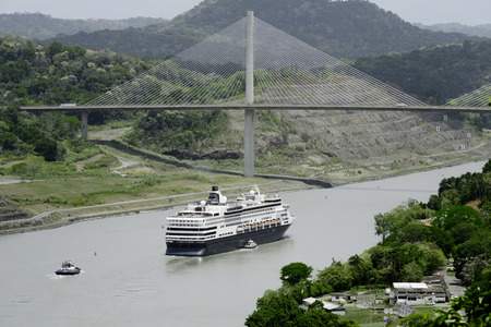 Large cruise ship passing under Panamas Centennial Bridge, Panama Canal