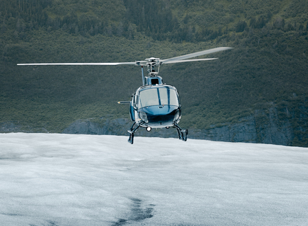 helicopter pilot: Single-engine helicopter landing on an ice field