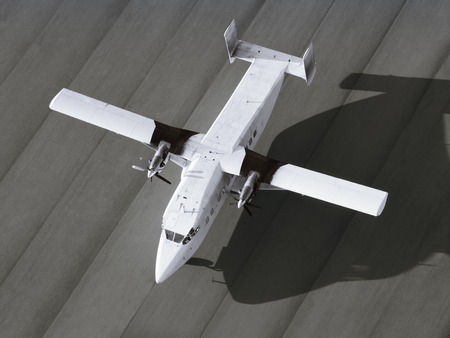 fixed wing aircraft: Top view of a single engine airplane ready to take off
