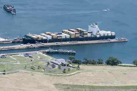 exiting: Large cargo ship exiting Gatun Locks, Panama Canal
