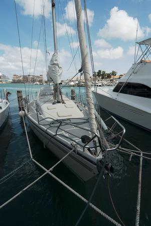 super yacht: Sail boats moored at Oranjestad Harbor, Aruba Island Stock Photo