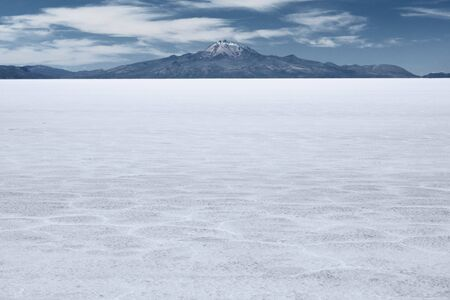 dormant: The worlds largest salt flat and dormant volcano Tunupa at the far background, Salar de Uyuni, Bolivia