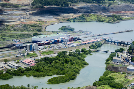 Aerial view of Miraflores Locks. Cargo ships passing through Miraflores Locks at Panama Canal.