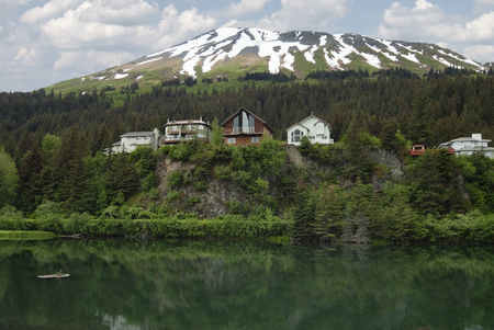lodges: Cliffside lodges  wooden houses on Cliff View Place Looking Over The Lagoon, Seward, Kenai Peninsula Borough, Alaska, USA Stock Photo
