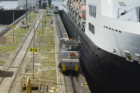 miraflores: Electric mules steering large cruise ship at the first locks on Panama Canal, Miraflores Locks, Pacific Ocean
