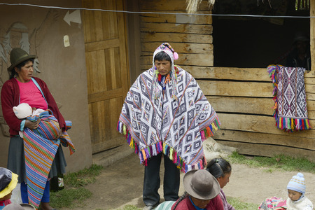 andes mountain: Wedding ceremony preparaton. View of the bride`s father wearing handwoven poncho and chullo - knitted hat with earflaps, Paru Paru, the highest-altitude community in La Parque de la Papa, Andes Mountain, Peru