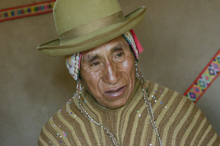 south american ethnicity: Portrait of a Native Peruvian man wearing typical andean robe, Paru Paru indigenous community, Andes Mountains. October 22, 2-12 - Paru Paru, Peru