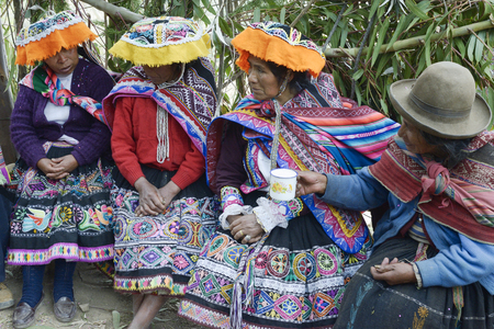 quechua indian: Indigenous women wearing handwoven skirts and ponchos, attending local wedding ceremony. October 22, 2012, Amaru, Peru Editorial
