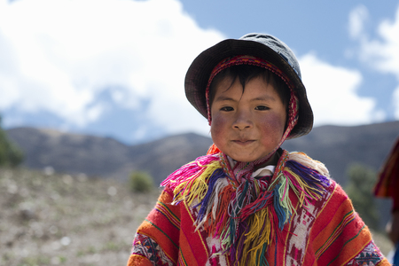 Portrait of a Peruvian boy dressed in colourful traditional handmade outfit. October 21, 2012 - Patachancha, Cuzco, Peru