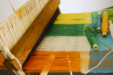 Vintage manual weaving loom with unfinished textile work