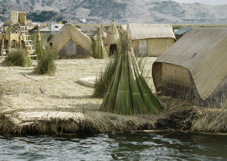 rushes: Houses on the Uros Floating Islands made of tortora rushes. October 17, 2012 - Lake Titicaca, Peru