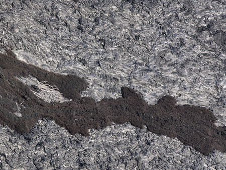 solidified: Patterns cracks and shapes from close up portion of black solidified lava, Hawaii