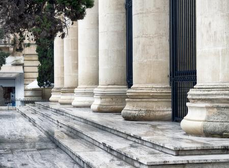 roman columns: Detail of a court house. Roman columns architecture in valletta, Malta