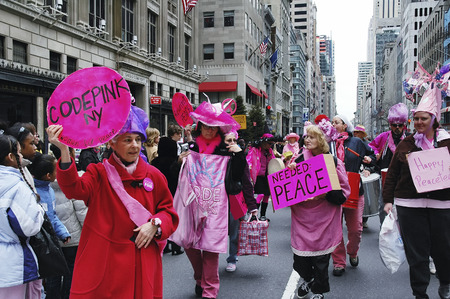 fifth avenue: Anti-war Code Pink demonstrators taking part in the Easter Parade on 5th avenue in New York City. March 27, 2005 - New York, USA Editorial