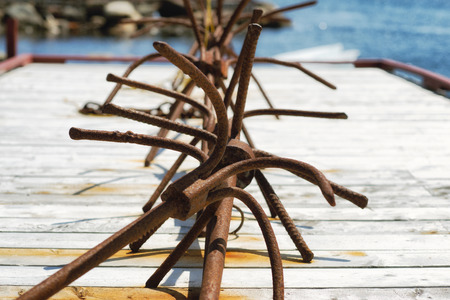 Many rusted anchors left to dry on the sun at Red Bay, Labrador Stock Photo