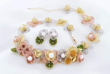Floral chiffon necklace and earrings with akoya pearls and gold Stock Photo