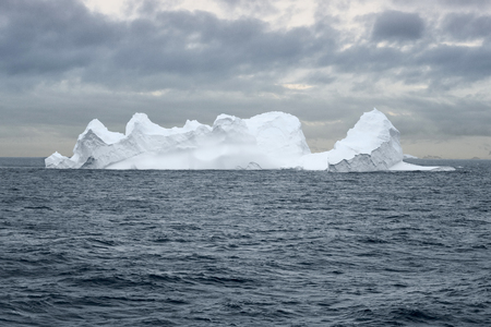 Large Iceberg floating in Bransfield Strait near the northern tip of the Antarctic Peninsula, Antarctica 写真素材