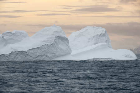 Large Iceberg floating at sunset in Bransfield Strait near the northern tip of the Antarctic Peninsula, Antarctica 写真素材