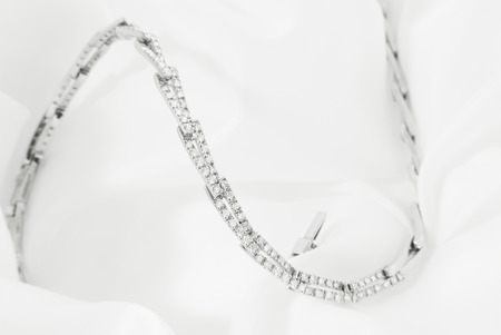 White Gold Necklace With Diamonds On Soft White Background