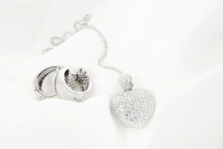 White Gold Earrings And Heart Shaped Pendant With Diamonds