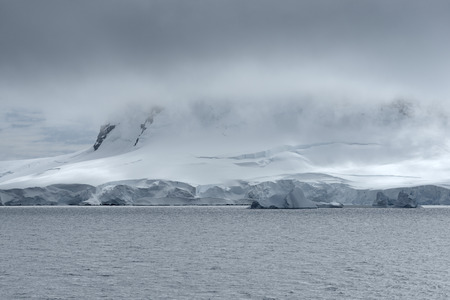 Heavy Cloud System Over The Coastline Of Neko Harbor, Andvord Bay, Antarctic Peninsula