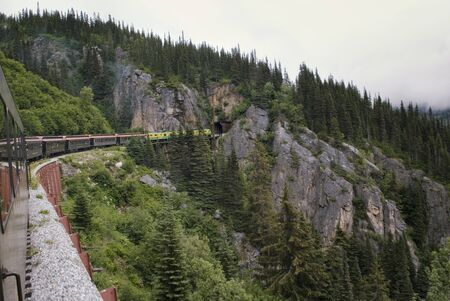 Alaska White Pass And Yukon Route Railroad Train Traveling Along Mountain Route