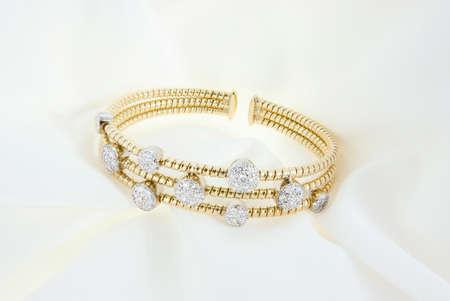 Yellow Gold Bracelet With Diamonds On Soft White Background